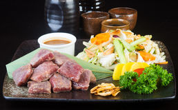 Japanese cuisine. beef cube on the background Royalty Free Stock Images