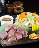 Japanese cuisine. beef cube on the background Royalty Free Stock Photography