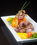 Japanese cuisine. beef cube on the background Stock Photos