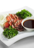 Japanese Cuisine - Beef Cuts. Japanese Cuisine - Beef Cold Cuts. Garnished with Parsley. Served with Sauce Royalty Free Stock Images