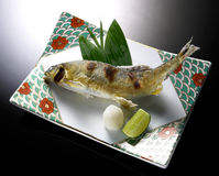 Japanese cuisine. Broiled pacific saury with salt, japanese cuisine close up Stock Photography