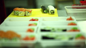 Japanese cuisine cafe. Cooking sushi and rolls stock video footage