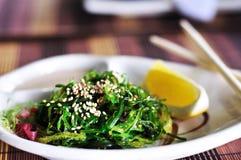 Japanese Cuisine - chuka. Chuka- japanese salad with  nuts sauce, lemon and sesame Stock Photos