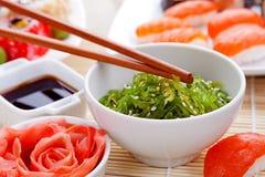 Japanese Cuisine - Chuka Seaweed Salad. Ginger and sushi Royalty Free Stock Image