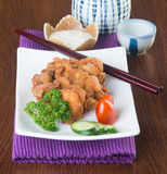 Japanese cuisine. fried chicken on the background. Stock Photography