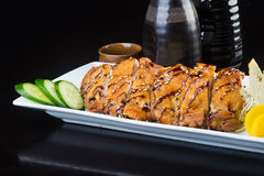 Japanese cuisine. fried chicken on the background Royalty Free Stock Photo