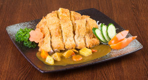 Japanese cuisine. fried chicken curry on the background Royalty Free Stock Image