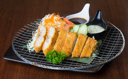 Japanese cuisine. fried fish on the background Royalty Free Stock Photos