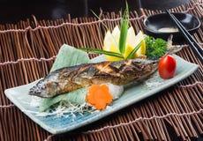 Japanese cuisine. fried fish on the background Stock Photo