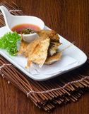 Japanese cuisine. fried fish on the background Stock Photos
