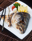 Japanese cuisine. fried fish head on the background Royalty Free Stock Photos