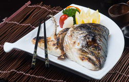 Japanese cuisine. fried fish head on the background Royalty Free Stock Image