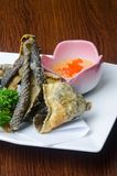 japanese cuisine. fried fish skin on the background royalty free stock image