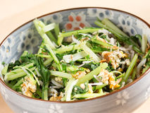 Japanese cuisine, fried potherb mustard leaf and egg. In the bowl Stock Photos