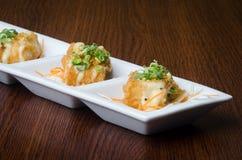 Japanese cuisine. fried tofu on the background Royalty Free Stock Image