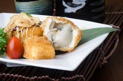 Japanese cuisine. fried tofu on the background Royalty Free Stock Photo