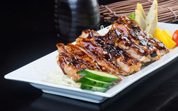 Japanese cuisine. grilled chicken on the background Stock Images