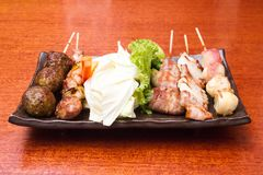 Japanese cuisine Grilled, Japanese skewered meat,Yakitori. Cooking in Japanese Style. Japanese Cuisine Stock Photos