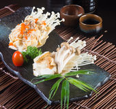 Japanese cuisine. grilled shell fish on the background Royalty Free Stock Photo