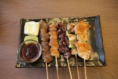 Japanese cuisine Grilled, teriyaki skewers Yakitori. On a plate royalty free stock image