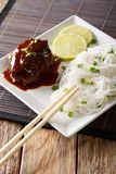 Japanese cuisine: hambagu steak with rice vermicelli and lime cl Royalty Free Stock Photography