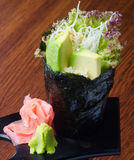 Japanese cuisine. hand roll on the background Royalty Free Stock Image