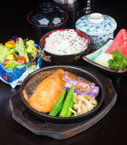 Japanese cuisine. hot plate fish on the background Stock Image