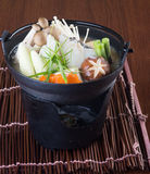 Japanese cuisine. hot pot on the background Stock Images