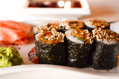 Japanese cuisine. Maki sushi. Hosomaki, Unagi maki, eel, avocado Royalty Free Stock Photography