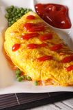 Japanese cuisine: Omurice with rice, green peas and ketchup clos Stock Photography