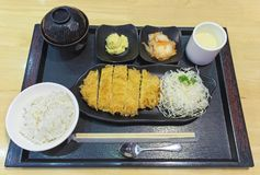 Japanese cuisine, pork deep fried cutlet Japanese food famous, Tonkatsu. Tonkatsu served with rice, miso soup, Chawanmushi and sal stock image