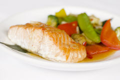 Japanese cuisine. Red fish with vegetables Royalty Free Stock Photography