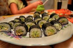Japanese cuisine rolls on a platter Royalty Free Stock Photos