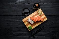 Philadelphia sushi roll over dark wooden background Stock Images
