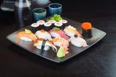 Japanese cuisine. sushi set on the background. Japanese cuisine. sushi on background royalty free stock photos