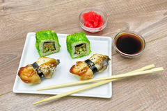 Japanese Cuisine - Sushi c smoked eel and rolls with caviar. Stock Image