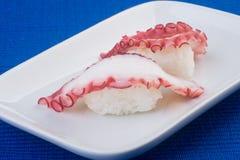 Japanese cuisine. sushi octopus on the background. Japanese cuisine. sushi octopus on background Stock Photo