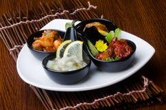 Japanese cuisine. sushi octopus on the background. Japanese cuisine. sushi octopus on background Royalty Free Stock Photo