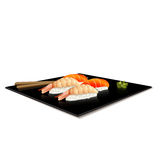 Japanese cuisine: sushi on a plate with reflection Stock Photography
