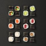 Japanese cuisine. Sushi rolls set over dark background. Stock Photo