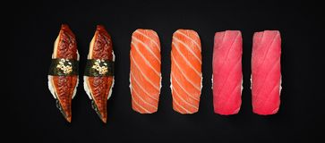 Japanese cuisine. Sushi set over dark background. Royalty Free Stock Photo