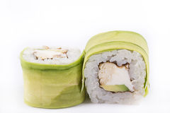 Japanese Cuisine, Sushi Set: roll with eel, cream cheese, Japanese omelette, avocado on a white background. Stock Photos
