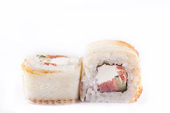 Japanese Cuisine, Sushi Set: roll with eel, smoked salmon, cream cheese, cucumber, paprika, teriyaki sauce, sesame on a white back Stock Photography