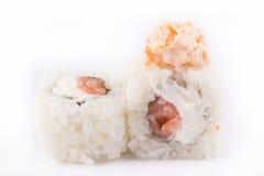 Japanese Cuisine, Sushi Set: roll with salmon, shrimp, cream cheese, tobiko caviar, Japanese mayonnaise on a white background. Stock Photos