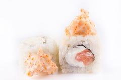Japanese Cuisine, Sushi Set: roll with salmon, shrimp, cream cheese, tobiko caviar, Japanese mayonnaise on a white background. Stock Image