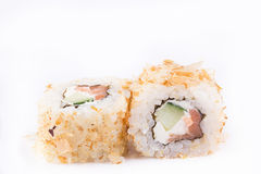 Japanese Cuisine, Sushi Set: roll with shavings of tuna, salmon, cream cheese, cucumber on a white background. Royalty Free Stock Photo