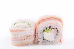 Japanese Cuisine, Sushi Set: roll with smoked breast, cream cheese, Chinese salad and bacon on a white background. Stock Photography