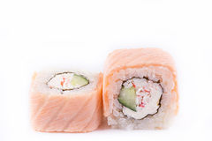 Japanese Cuisine, Sushi Set: salmon roll with cheese, cucumber and crab meat on a white background Royalty Free Stock Image