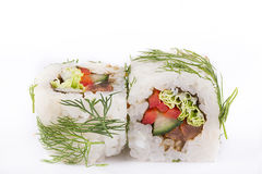 Japanese Cuisine, Sushi Set: Vegetarian roll with paprika, cucumber, tomato, Chinese salad and greens on a white background. Royalty Free Stock Photography
