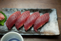 Japanese Cuisine Tuna Sushi and sake Stock Image